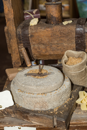 Ancient Stone Mill: Manual Grinder Wheel with Crank and Wooden Press for Pasta.