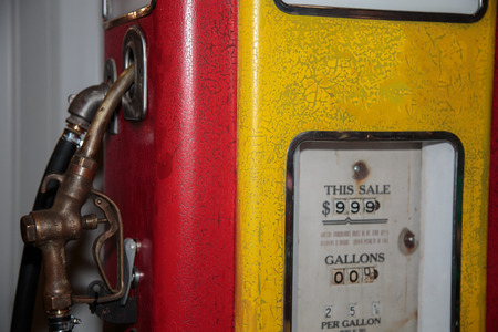 Yellow Vintage Red and Brilliant Gasoline Pump.