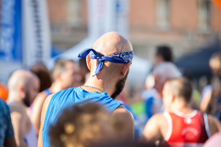 Bald Marathon Runner with a Bandana on his Head Ready to Take Part in the Race.
