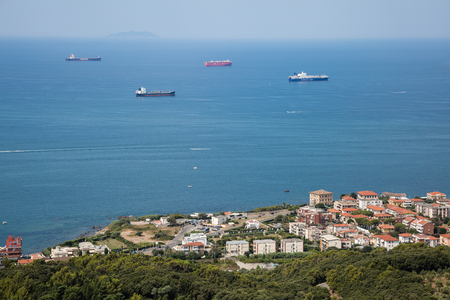 Aerial View of Empty Cargo Ships near the Coast with Calm Seas. Stock Photo