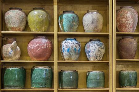 Antique Coloured Porcelain Empty Vases Displayed on a Shelf.
