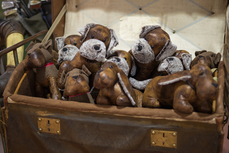 Antique Vintage Toy: Brown Leather Dogs inside a Suitcase. Stock Photo