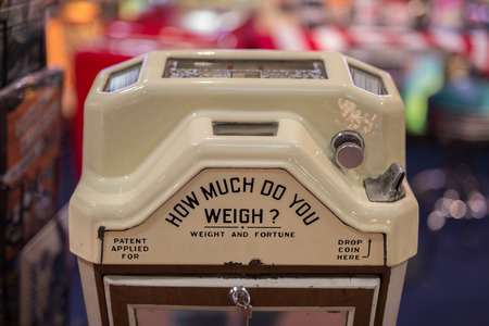 Public White Weight Scale and Fortune Teller.