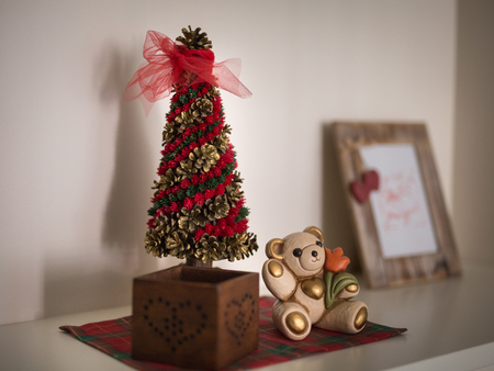 Christmas Decorations, Ornaments and Wooden Photo Frame on a Furniture in the House.