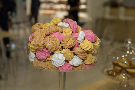 Group of Colorful Meringues inside a Glass Tray. Stock Photo