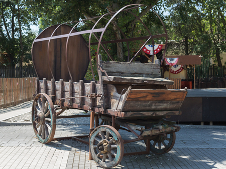 Antique Wooden Wagon With Wheels and Metal Structure.
