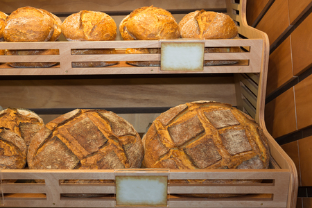 Group of Various Types of Bread, and Loaves inside a Bakery.