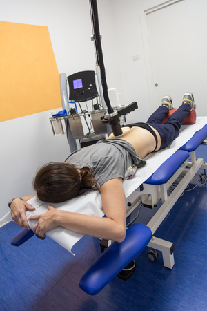 Diamagnetic Pump for Pain Therapy: Woman lying on aBed Undergoing Therapy.