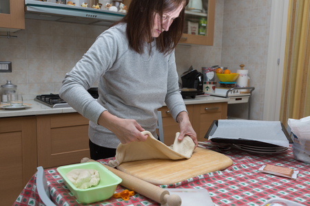 Preparing Pizza at Home: Woman Making a Delicious Pizza with Sausage and  Cheese
