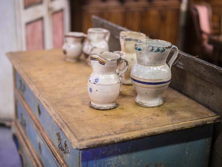 Decorative Handmade Porcelain Vases on top of an Antique Wooden Furniture. Reklamní fotografie
