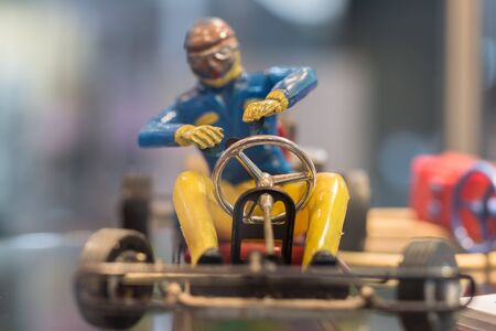 Vintage Plastic Toy of a Pilot with Helmet and Glasses Driving a Go-Kart.