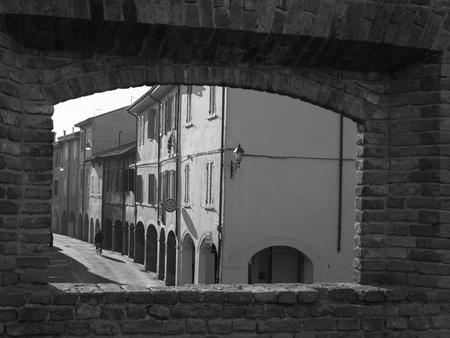 View from a Window in the Castle: Main Street, Colonnade and Houses in Fontanellato in Parma, Italy.