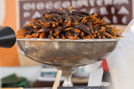 Orange Little Sticks of Peel Covered with Chocolate on Silver-plated Bowl