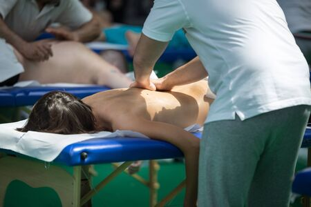 Athletes Back Professional Massage on Bed after Sport Fitness Activity. 写真素材