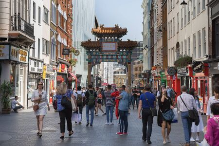 Wardour Street street in Soho with Traditional Chinese Paifang, London Chinatown.