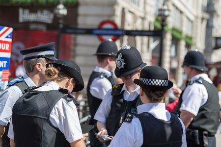 Street Photography: Group of London Policemen with Their Uniform.