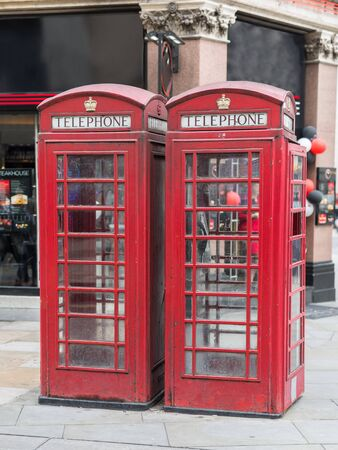 Two Vintage Red Phone Call Boxes in Central London.