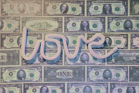 Group of Dollar Money in Line with Love Sign