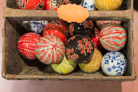Group of Colorful Japanese Hand-Painted Spheres inside a Basket.