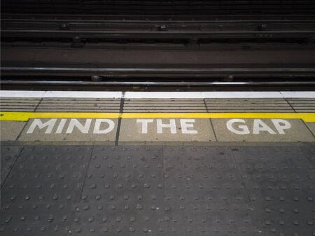 Mind The Gap Sign: Underground in Central London.