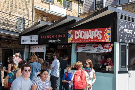 People in Camden Town Market in London: Street Food.