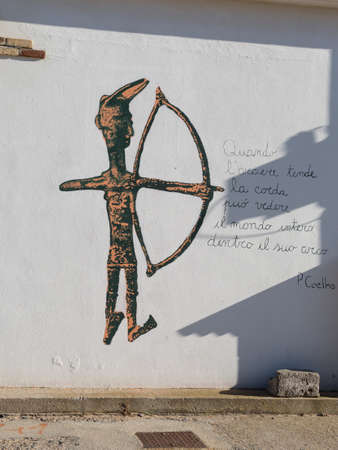 Stylized Representation of an Archer on a White Wall.