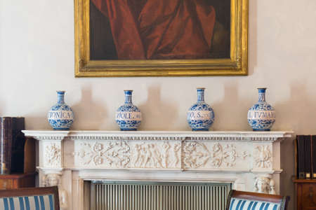 Decorative Handmade Porcelain Vases over a fireplace sill.