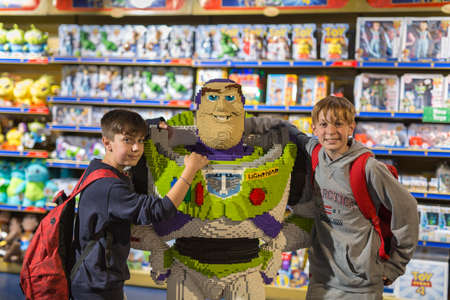 12-year-old Boys Photographed Next Buzz LightYear built with Pieces of Lego, a Character from the Pixar Movie.