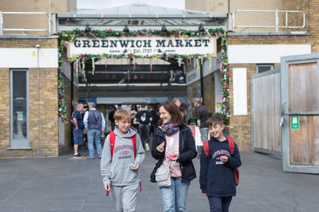 Woman and Two Boys Happy and Smiling in Greenwich Market, London. Editorial