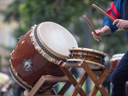 Man Playing Drums of Japanese Musical Tradition during a Public Outdoor Event.