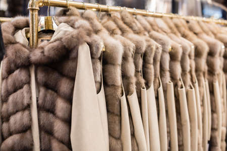 Group of Women's Furs Coats hanging on a Coat Hanger.