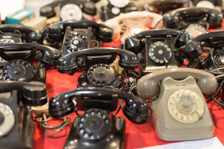 Set of Antique Telephones on a Table: Vintage Objects.