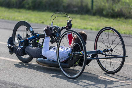 Disabled Athlete training with His Handbike on a Track. Фото со стока
