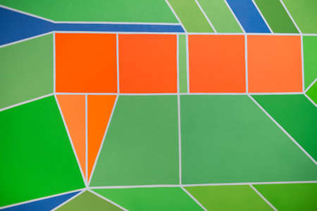 Paint on Canvas with Colored Geometric Figures.