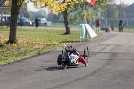 Disabled Athlete training with His Hand Bike on a Track.