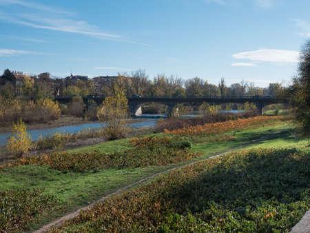 """Historic Bridge """"Ponte Italia� in the Center of Parma in Sunny Autumn Day, Italy. Banco de Imagens"""