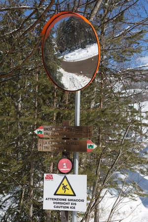 Wooden Directional Signs for Walks in the Italian Mountains of the Dolomites And Safety Mirror.