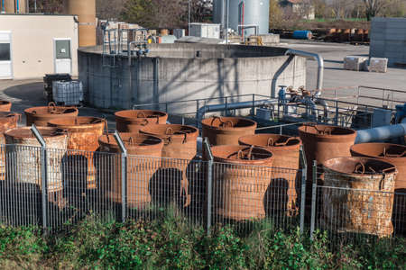 Group of Rusty Industrial Cylindrical Containers Grouped Outdoors.