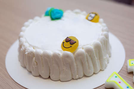 Cake Filled with White Cream and Gummy Smile-shaped Candy Emoticon. Banco de Imagens
