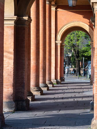 Arcade, Hallway and Columns - orange architecture in Public Square in Parma, Italy.