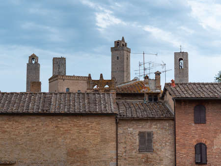 Details of Bell Towers and Brick Houses in San Gimignano in Tuscany, Siena - Italy. Фото со стока