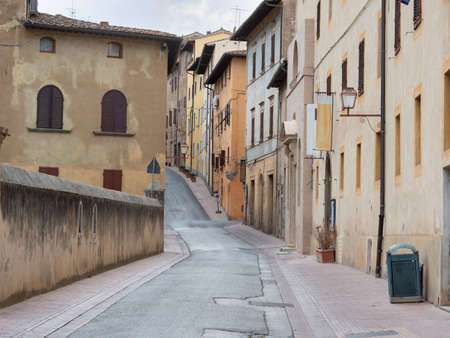 Typical Street with Ancient Houses in the Medieval Village of  San Gimignano, Siena - Italy.