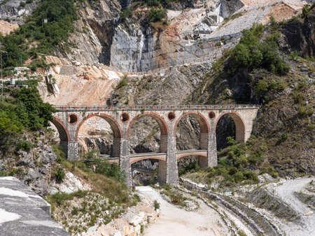 Bridge of Vara in Carrara, site of the Old Private Marble Railway - Tuscany, Italy. Фото со стока