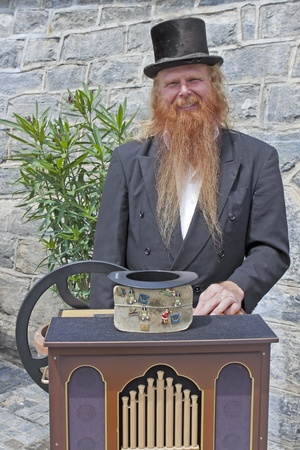 a man who plays often the hurdy-gurdy at the Lake Maggiore in Ascona Stock Photo