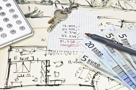 the blueprint of a house with keys, a calculator, a pencil, money and a calculation for expenses