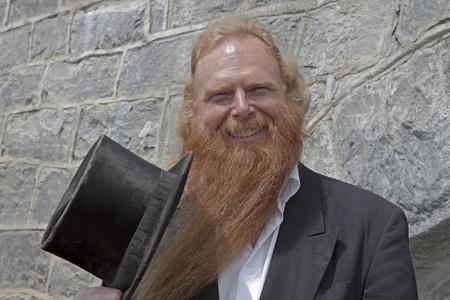 this man plays often the hurdy-gurdy in Ascona - Ticino - Switzerland Stock Photo