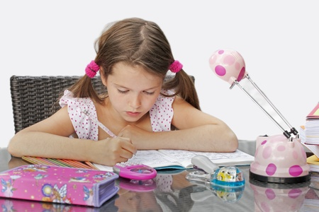 7 year old girl at the table with homework