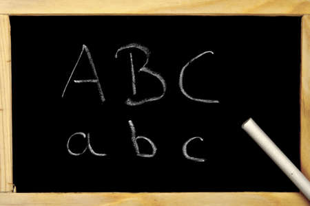 a chalkboard with the beginning of the alphabet ABC Stock Photo