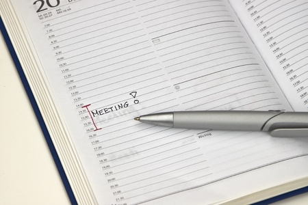 Calendar with pen and an entry for a meeting r Stock Photo
