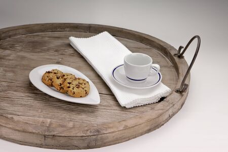 Chocolate chip cookies served on an antique wooden tray